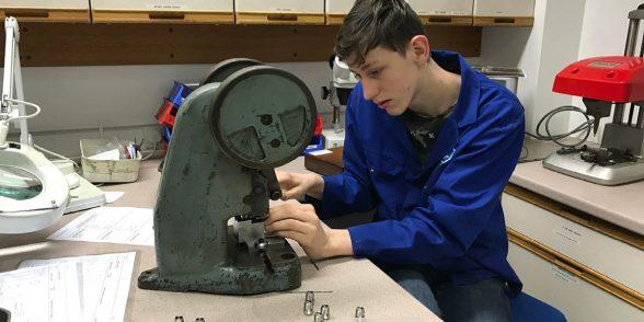 Apprentice Adam assembling components at APT
