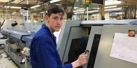 Our apprentice Adam monitoring a sliding head lathe