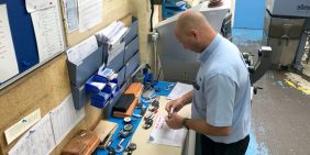Andy Stone inspecting a component sample during production